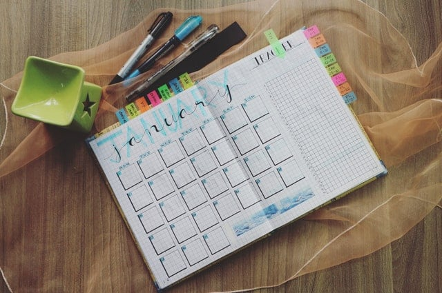 motivational planner with schedule and tabs