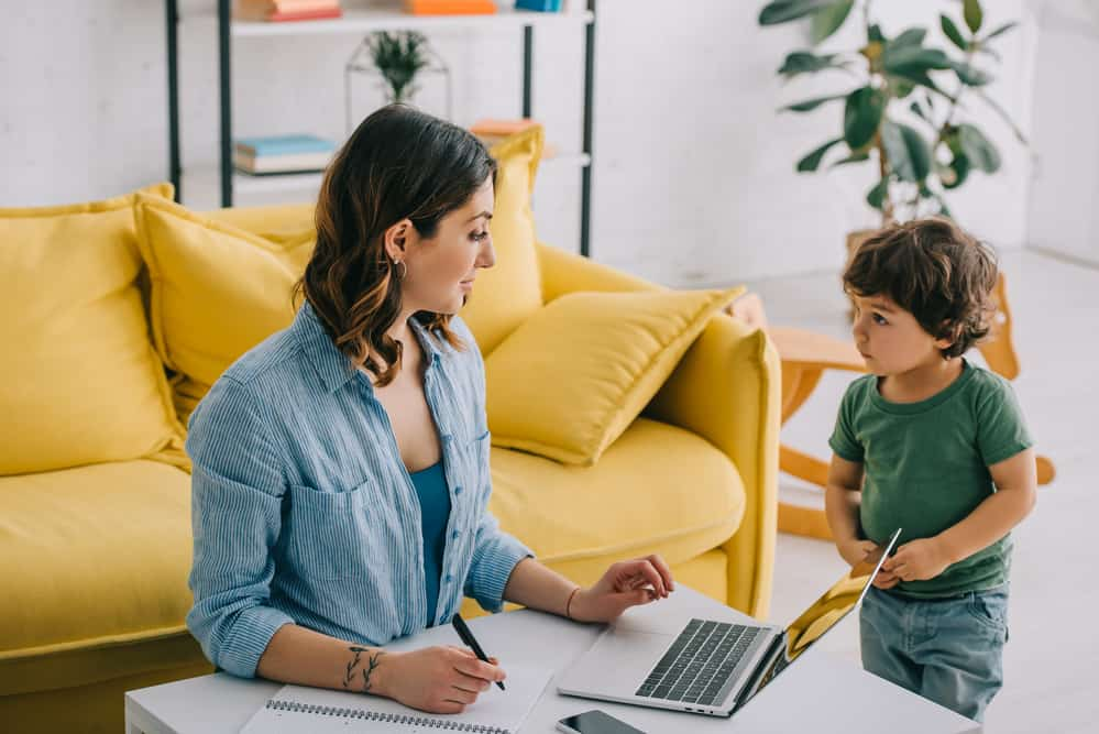 mom working from home with toddler in the same room