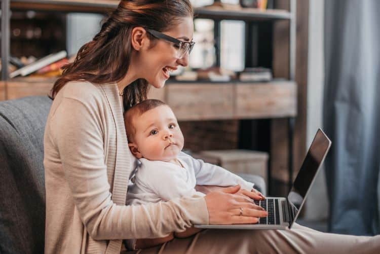 mom working as a virtual assistant with baby