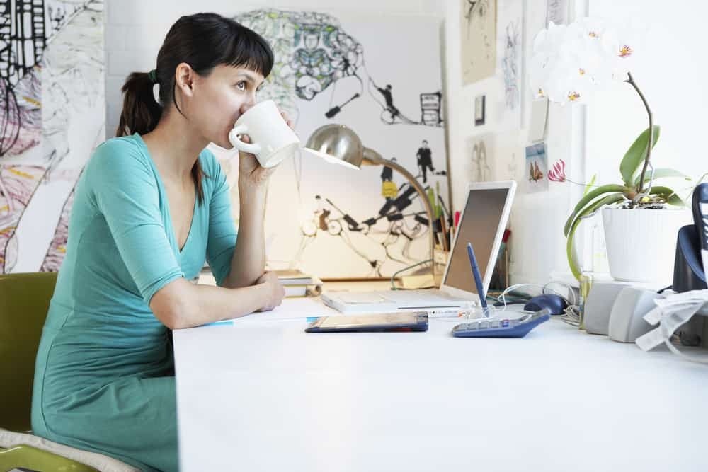 woman working from home and drinking coffee